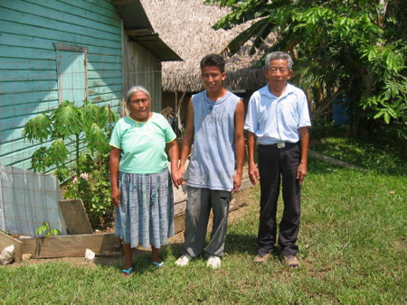 Petrona and Manuel Xi (pronounced She) with one of their grandsons—I first met them in Crique Sarco. In those days, nobody held hands with anybody.  Note Petrona's knee-length skirt.  Traditional Kekchi skirts are ankle-length and require seven yards of material.