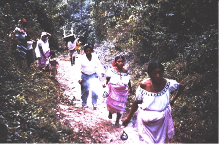 A religious procession from the Rio Blanco River (no bridge then) into Santa Elena.   The village was mixed Kekchi and Mopan Maya, although the women all wore traditional Mopan skirts and blouses because Kekchi skirts were too expensive and hard to get. (Photo by A. Terry Rambo)